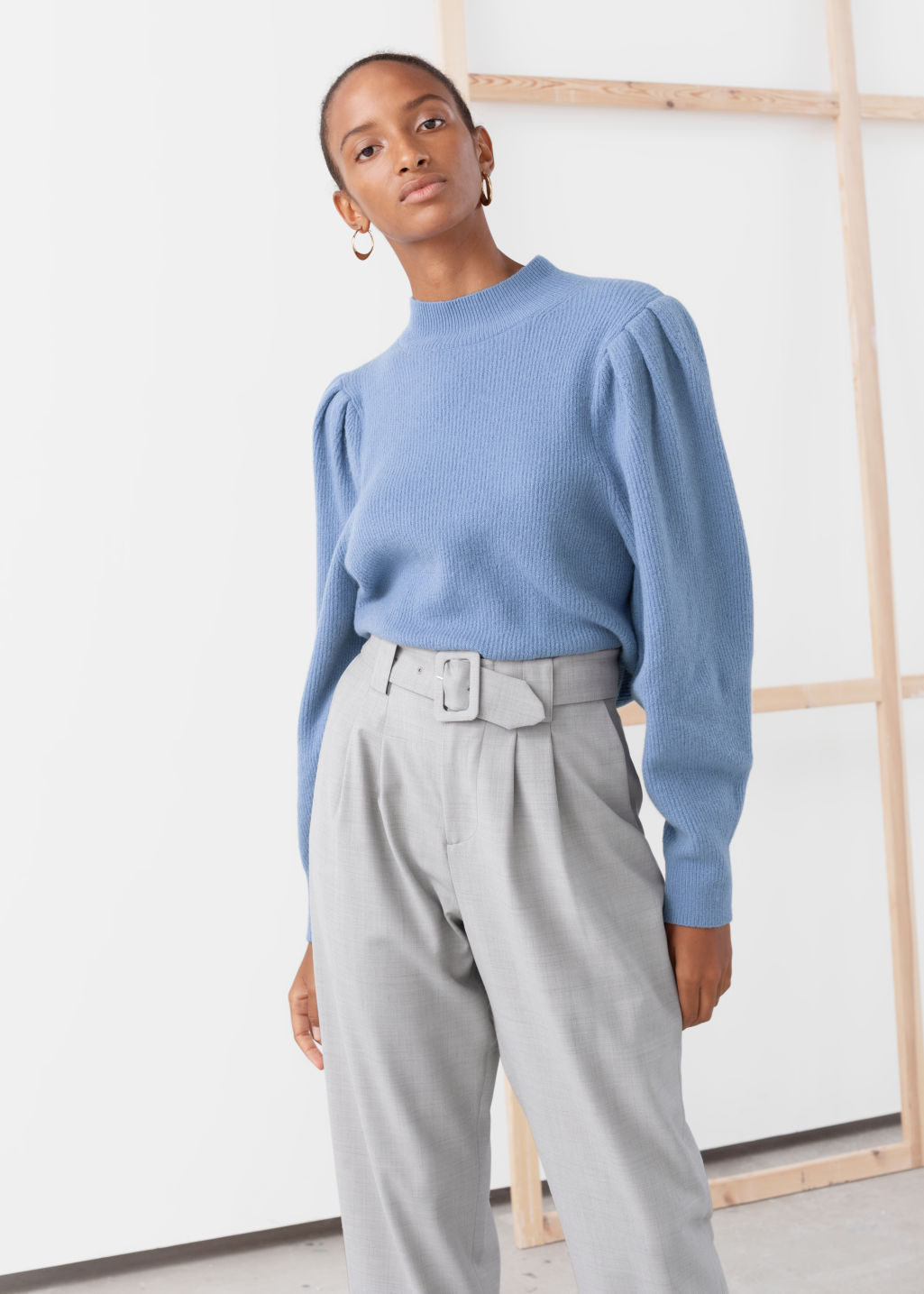 Model front image of Stories mock neck puff sleeve sweater in blue