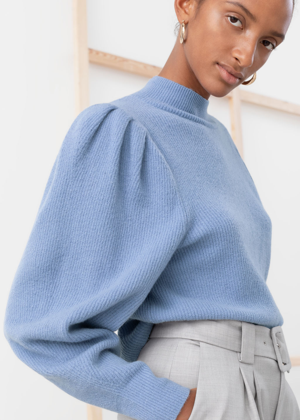 Model back image of Stories mock neck puff sleeve sweater in blue