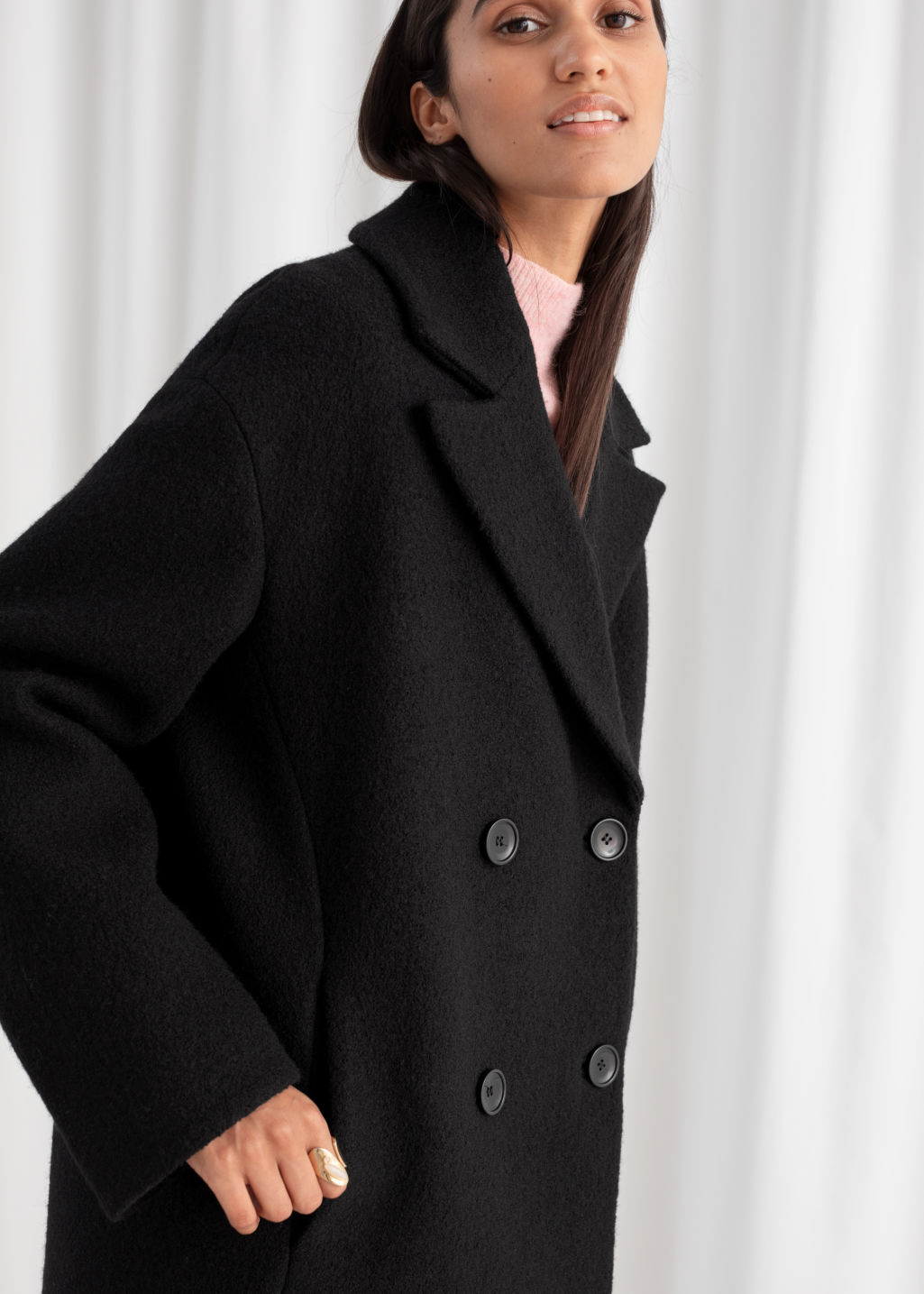 Model front image of Stories double breasted bouclé coat in black