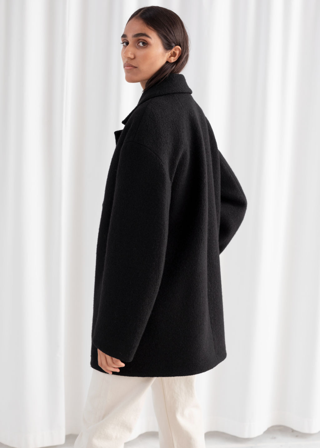 Model back image of Stories double breasted bouclé coat in black