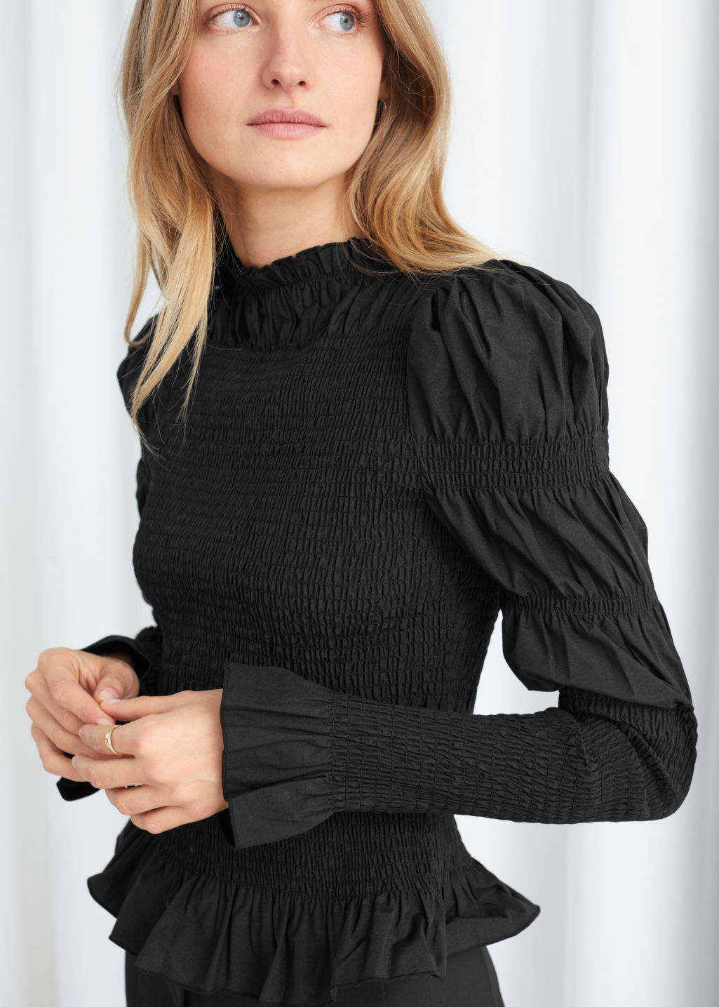 Model side image of Stories fitted smock panel blouse in black