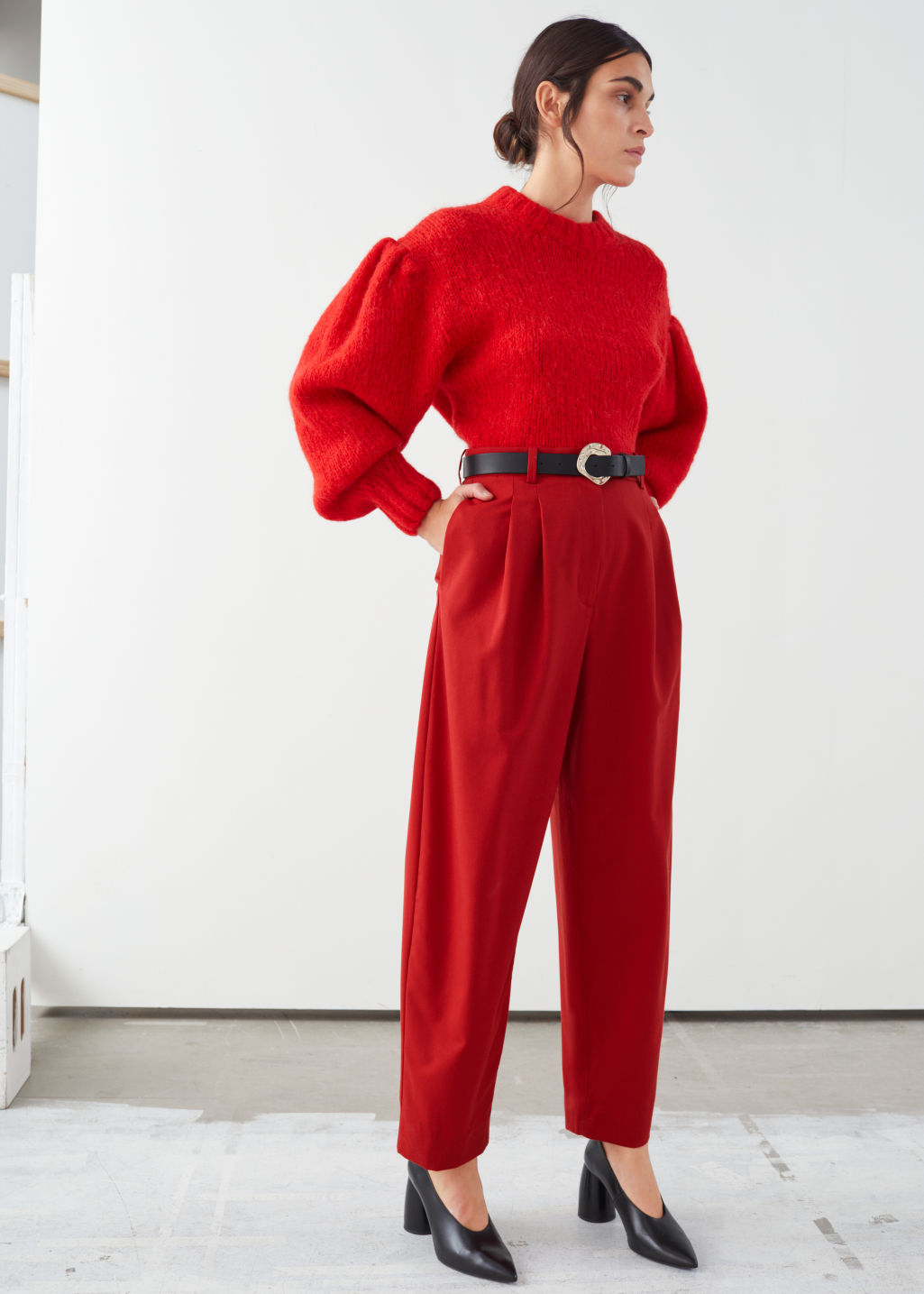 Model front image of Stories duo pleat tailored trousers in red