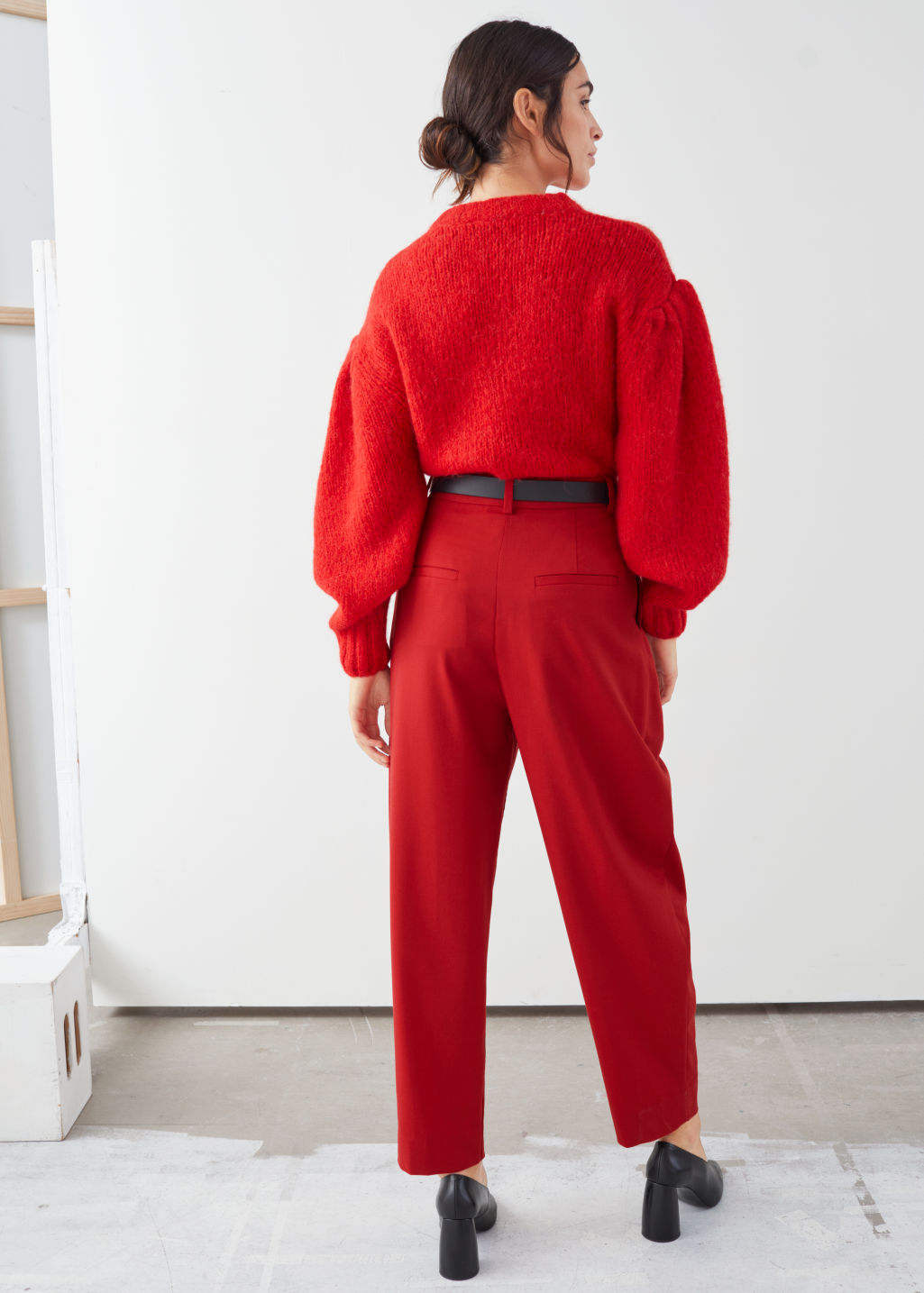 Model back image of Stories duo pleat tailored trousers in red