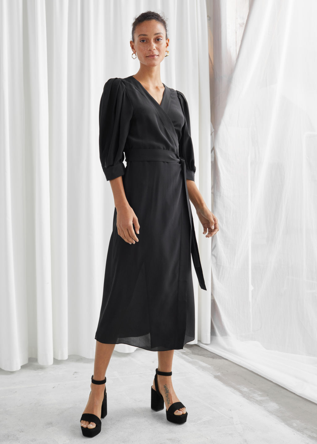 Model front image of Stories silk puff sleeve midi wrap dress in black