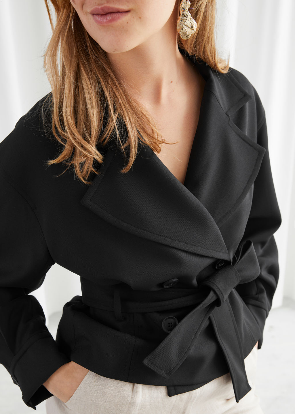 Model front image of Stories belted wool blend trench jacket in black