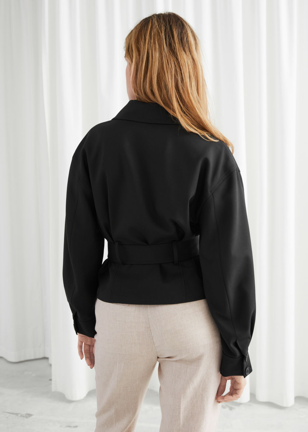 Model back image of Stories belted wool blend trench jacket in black