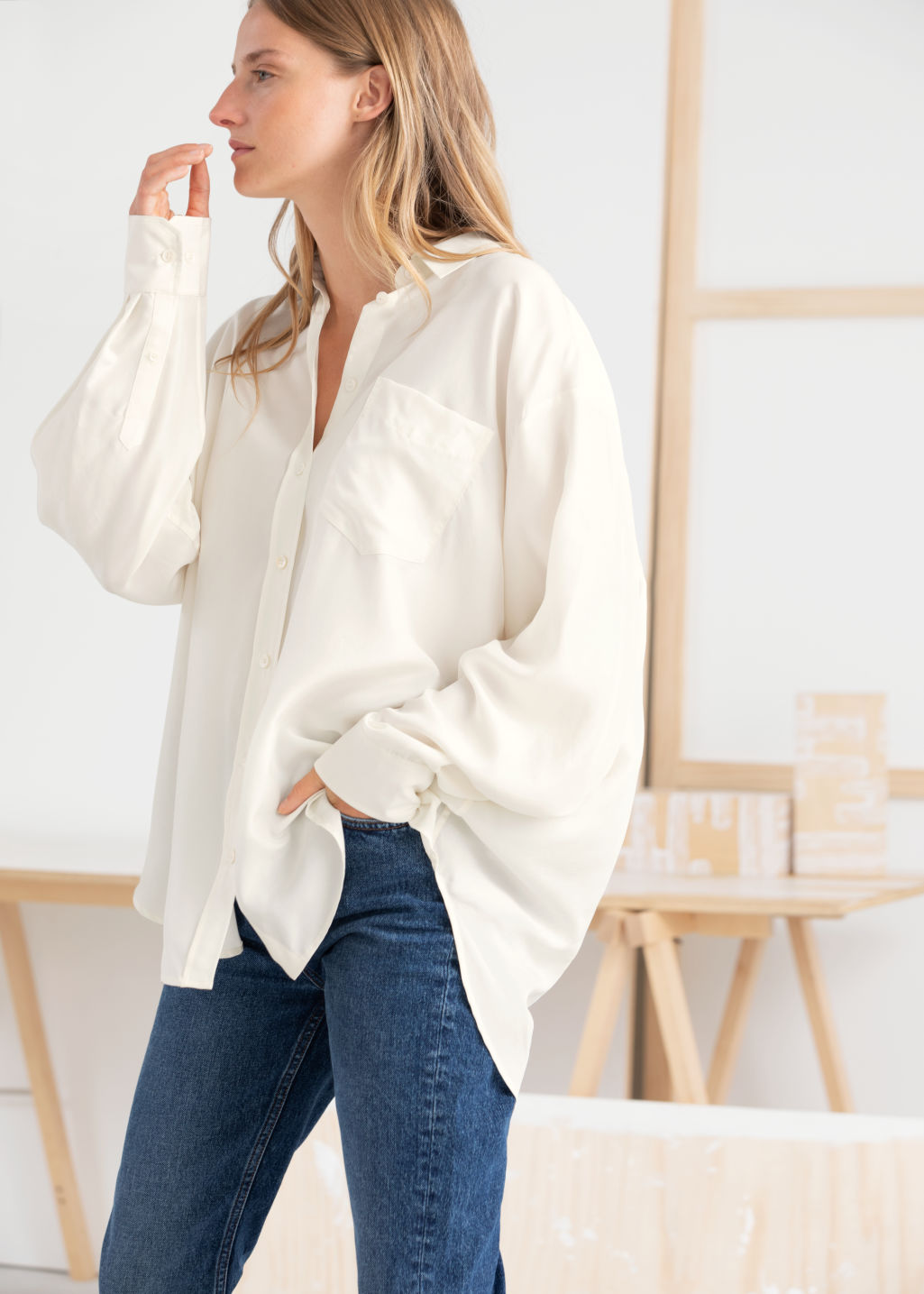 Model front image of Stories oversized silk shirt in white