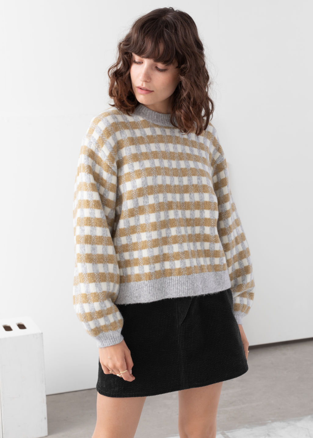 Model front image of Stories puff sleeve check knit sweater in white