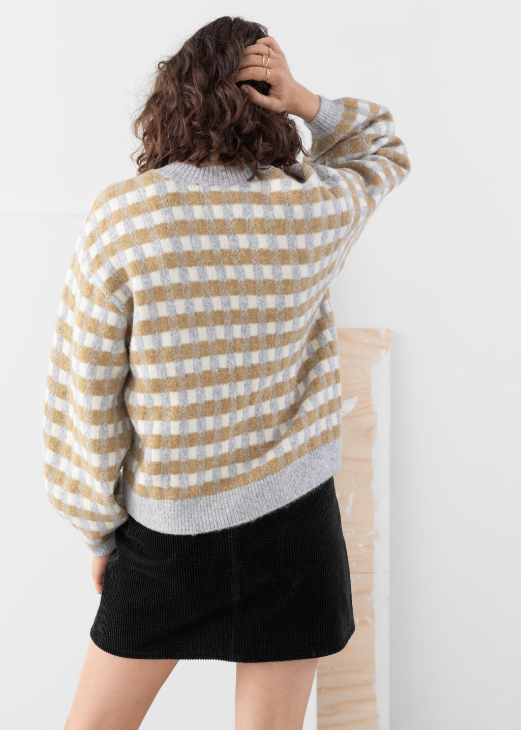 Model back image of Stories puff sleeve check knit sweater in white