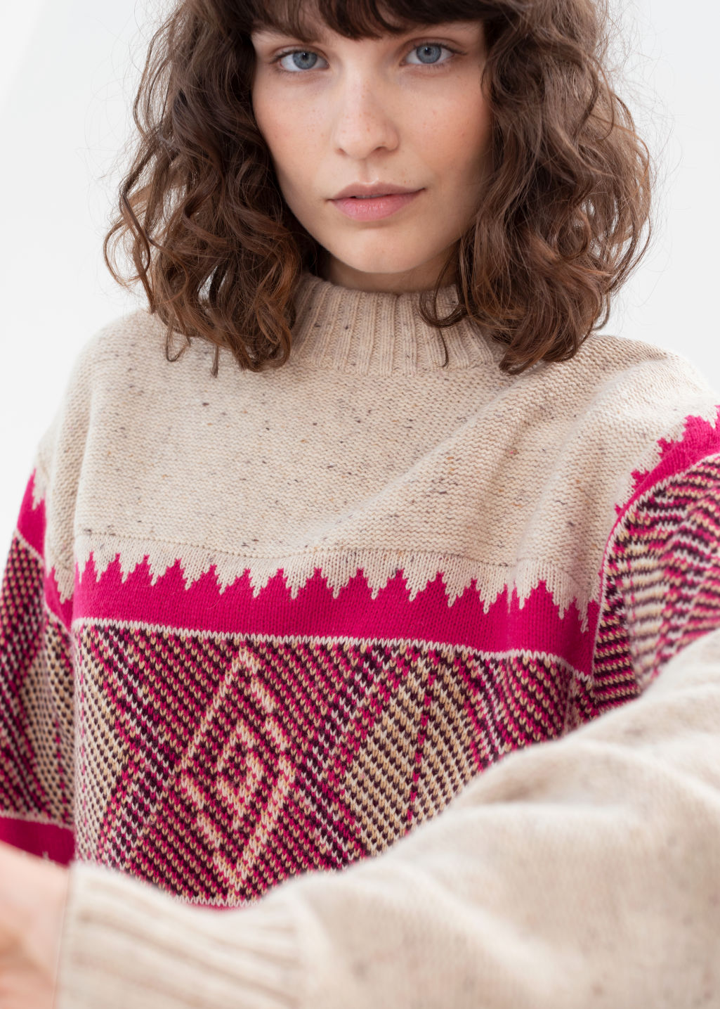 Model front image of Stories diamond knit wool blend sweater in beige