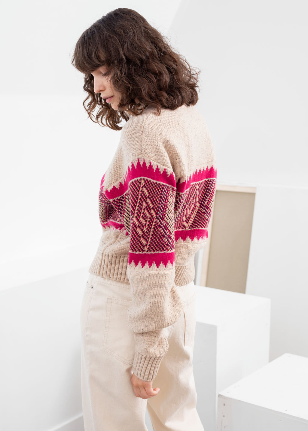 Model side image of Stories diamond knit wool blend sweater in beige