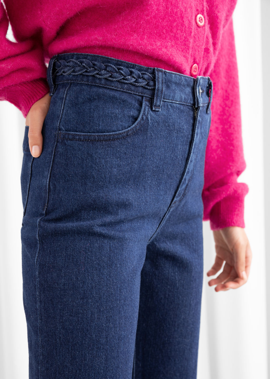 Model back image of Stories kick flare braided waist jeans in blue
