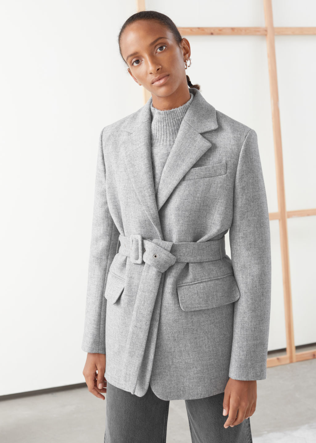 Model front image of Stories square buckle belted blazer in grey
