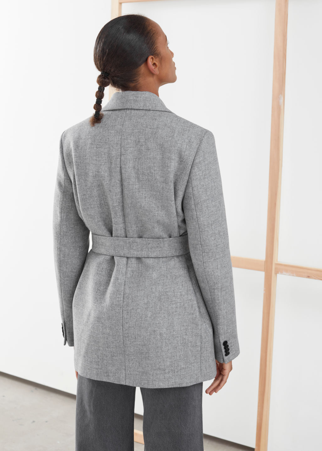 Model back image of Stories square buckle belted blazer in grey