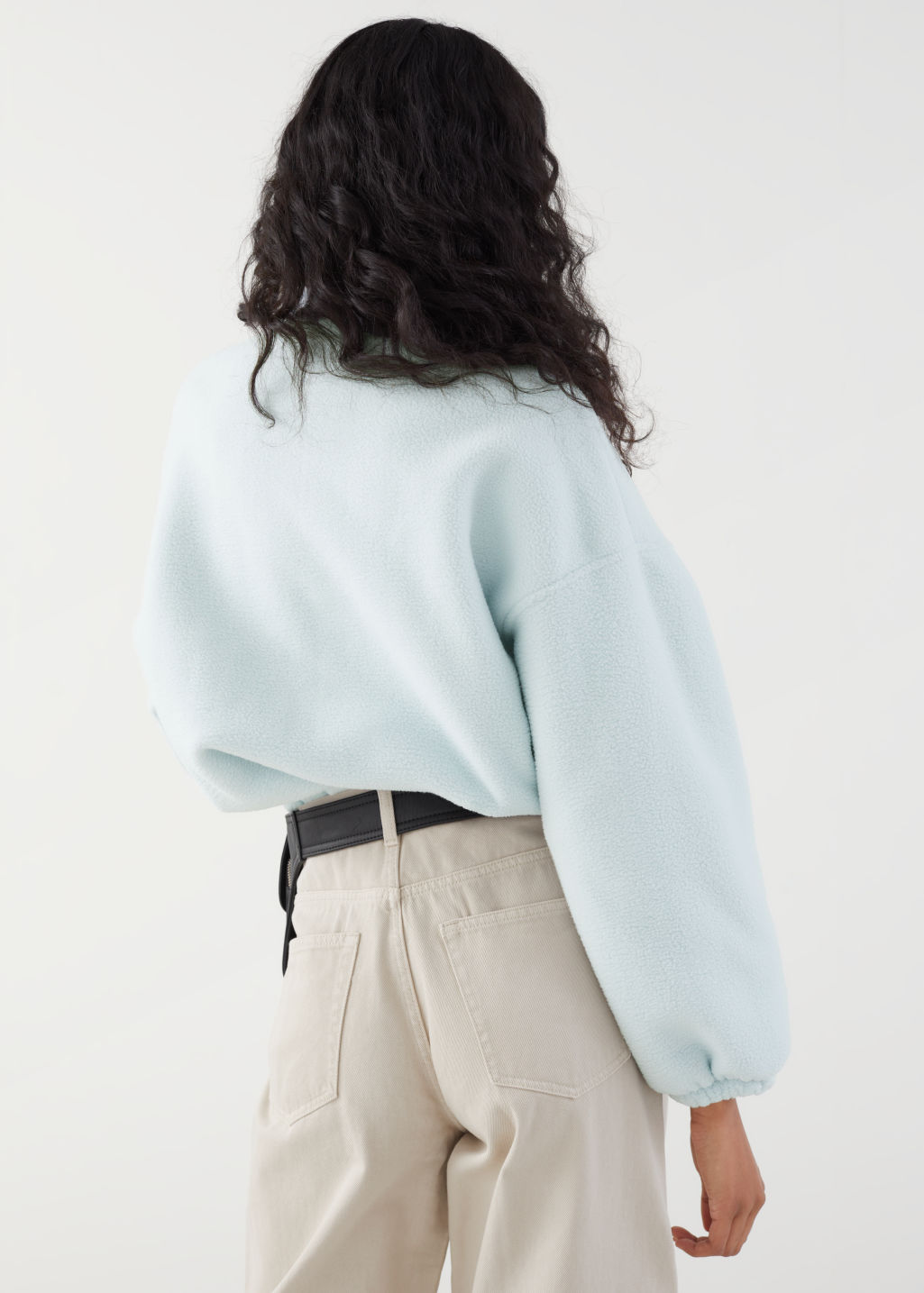 Model back image of Stories fleece mock neck pullover in turquoise