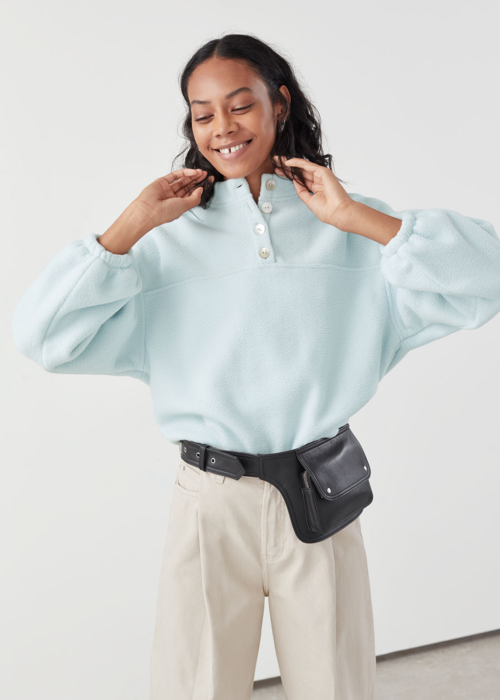 Model front image of Stories fleece mock neck pullover in turquoise