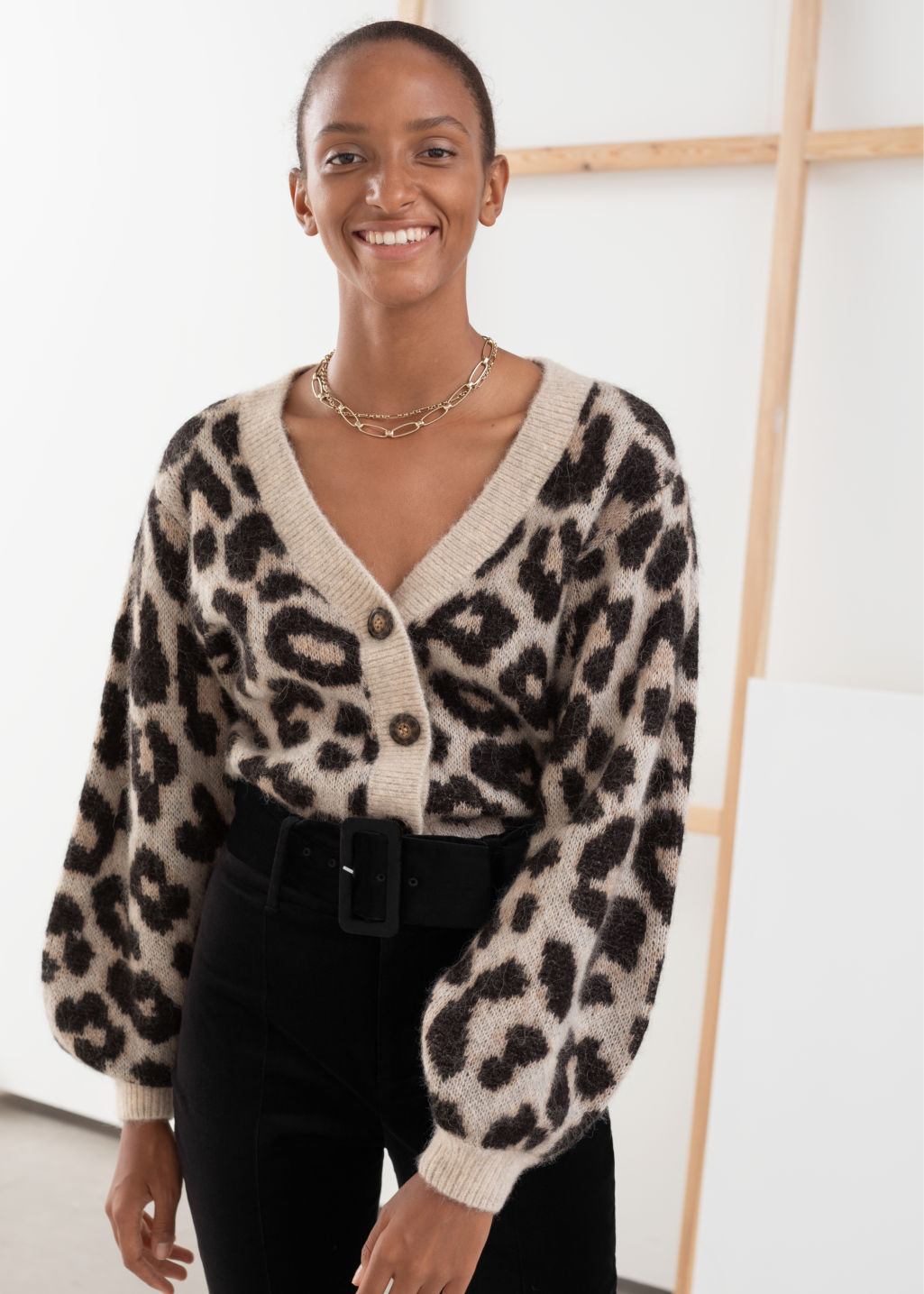 Model front image of Stories leopard puff sleeve wool blend cardigan in black