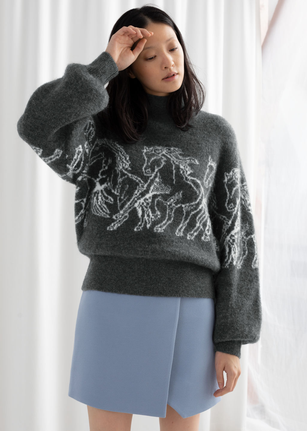Model front image of Stories horse motif knitted sweater in grey