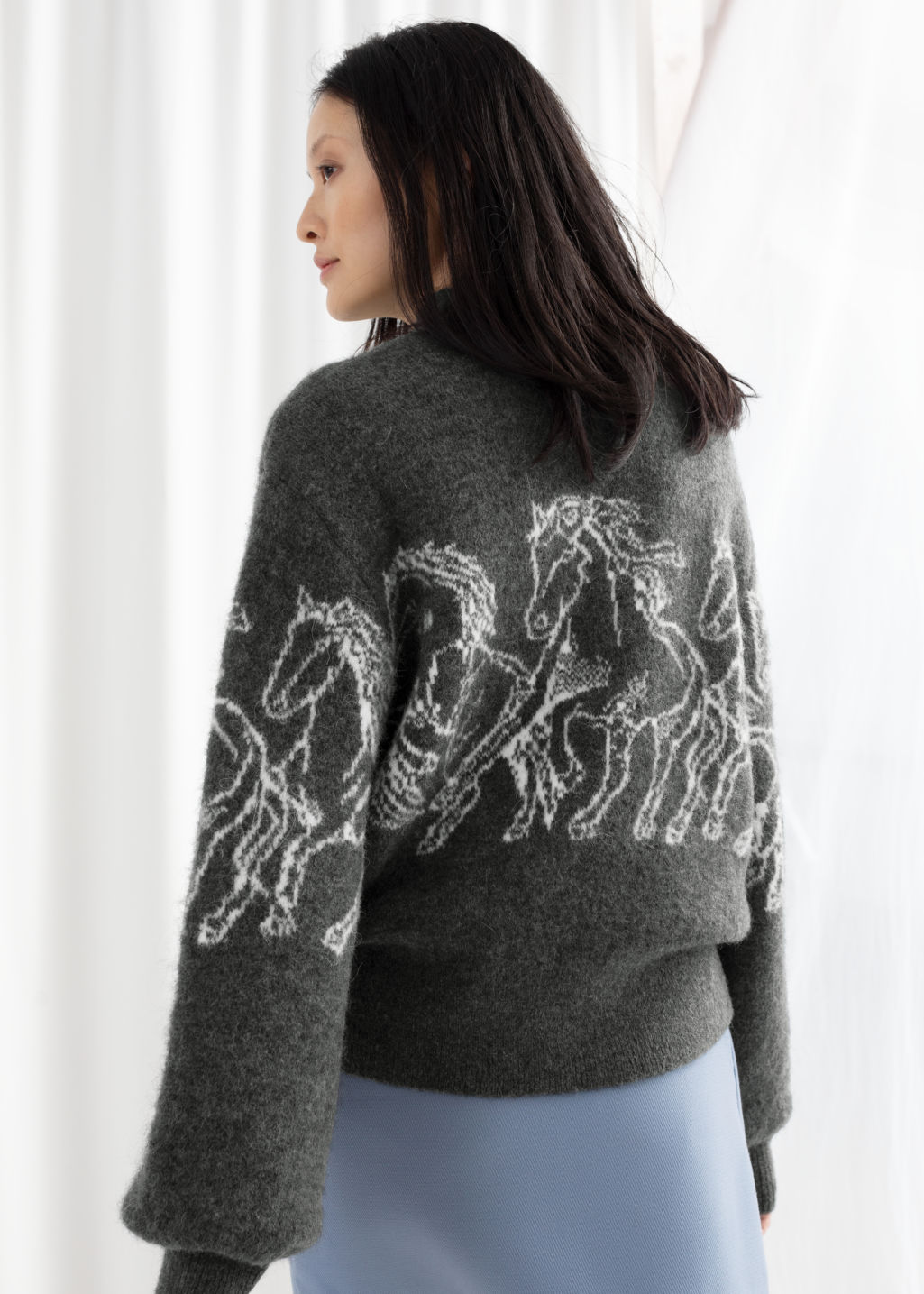 Model back image of Stories horse motif knitted sweater in grey