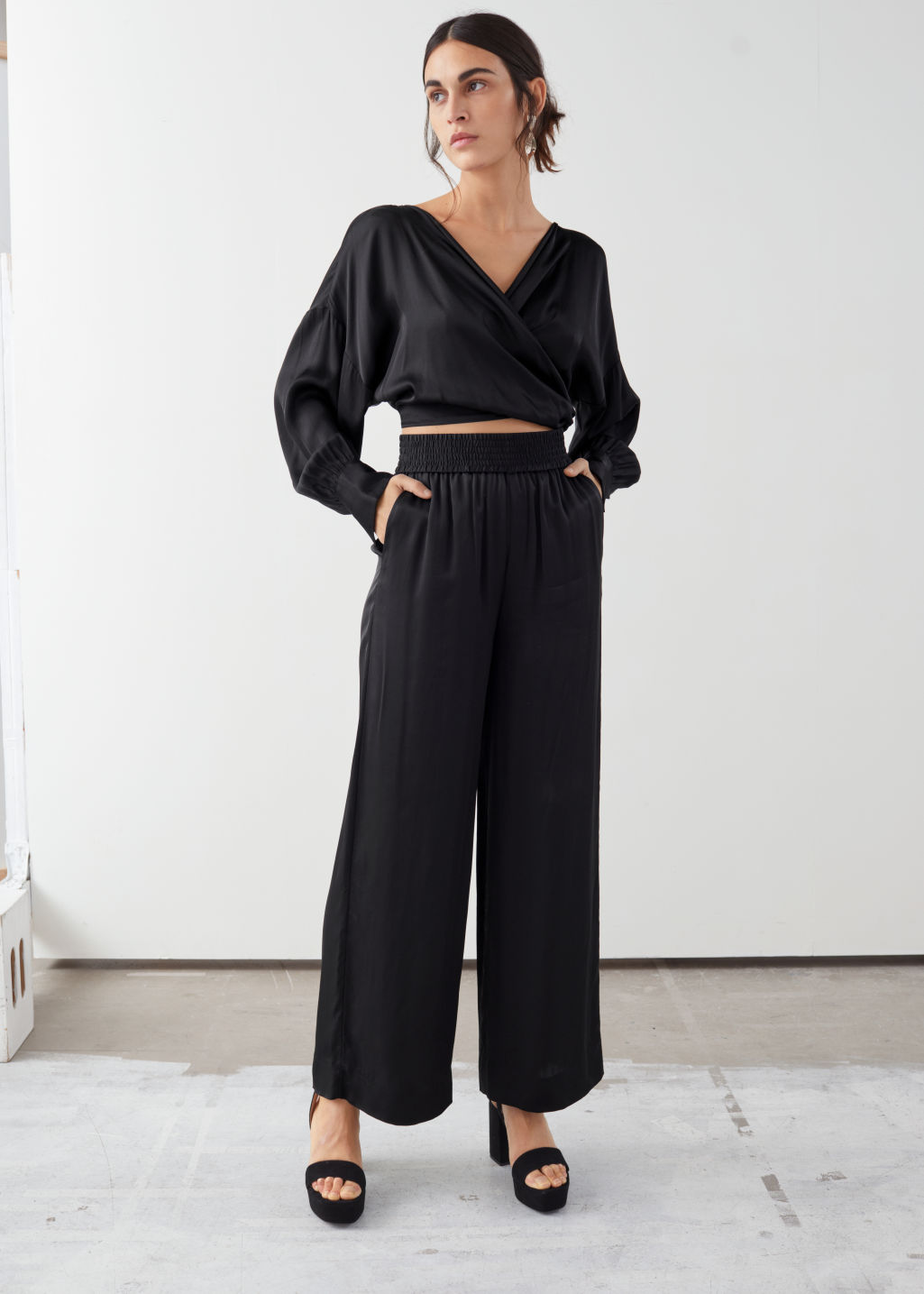Model front image of Stories satin wide leg flowy trousers in black