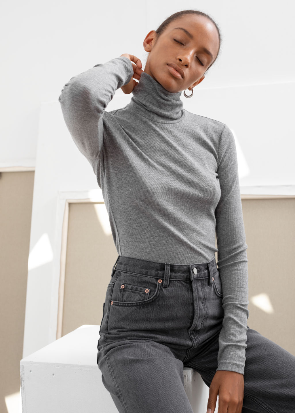 Model front image of Stories fitted lyocell ribbed turtleneck  in grey