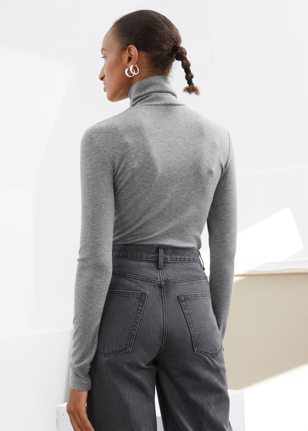 Model back image of Stories fitted lyocell ribbed turtleneck  in grey