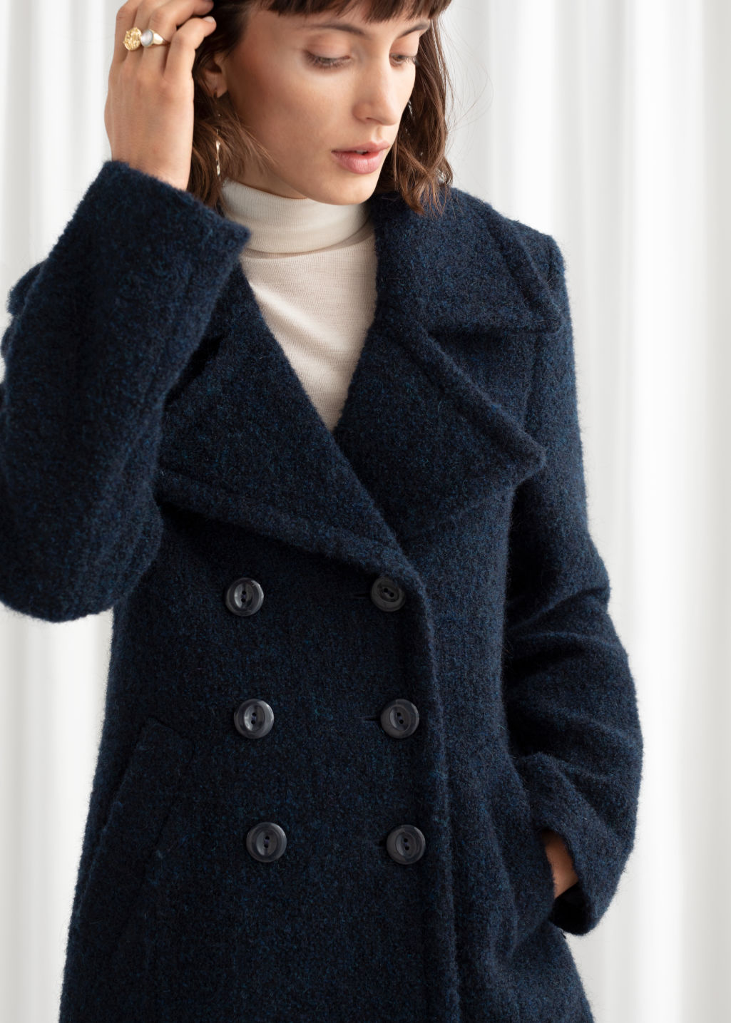 Model front image of Stories double breasted wool blend bouclé coat in blue