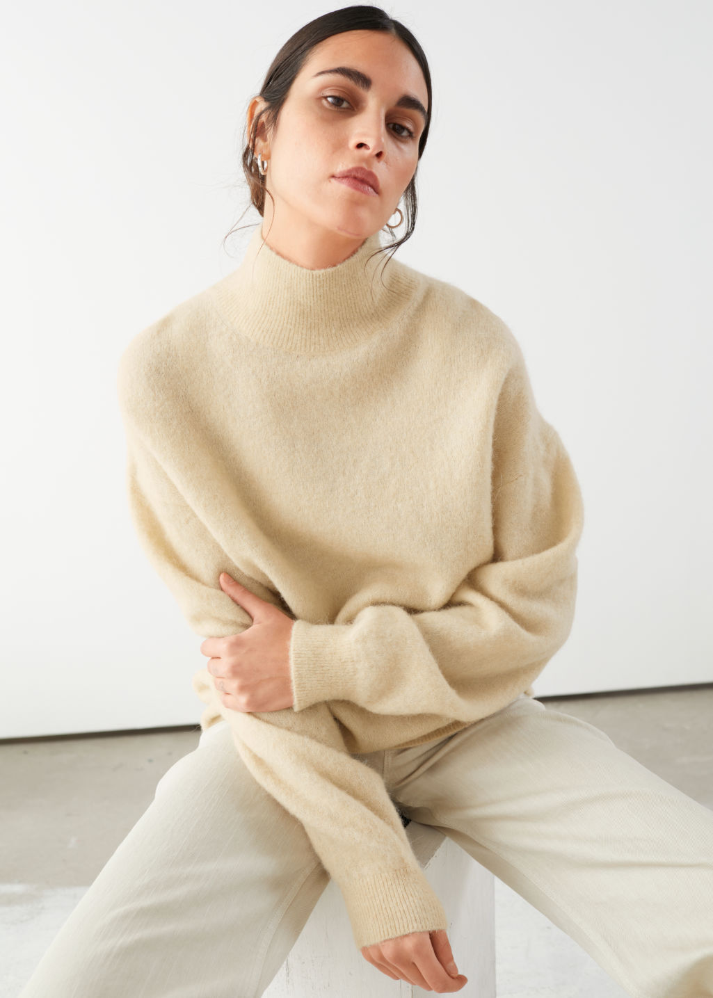 Model front image of Stories alpaca blend mock neck sweater in beige