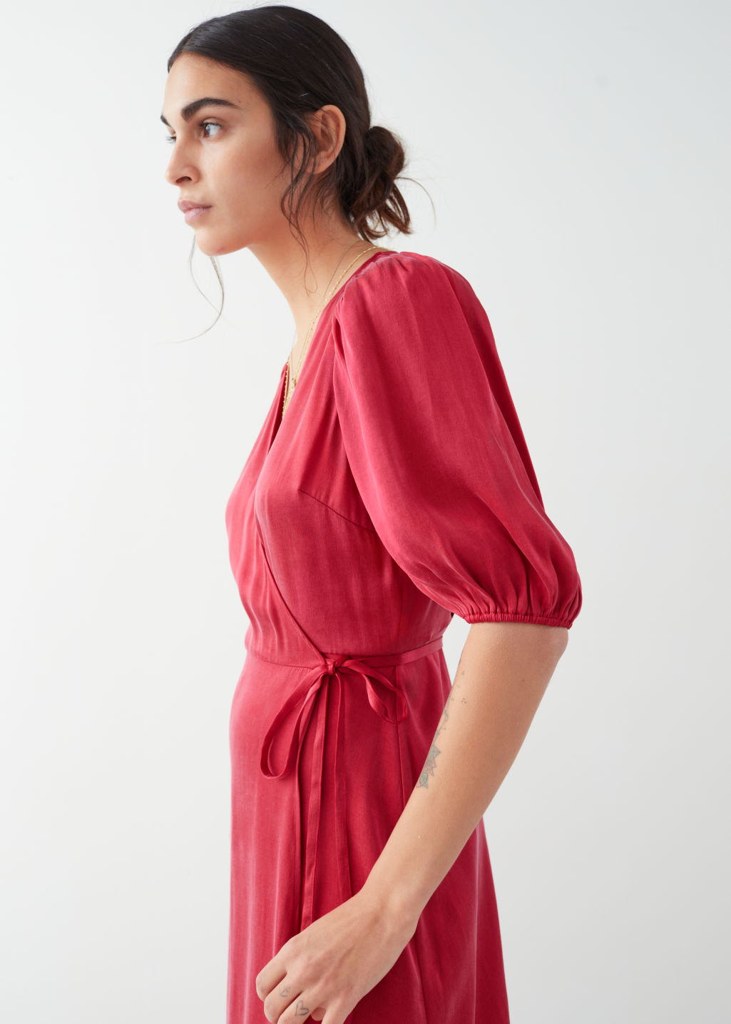 Model side image of Stories puff sleeve maxi wrap dress in red