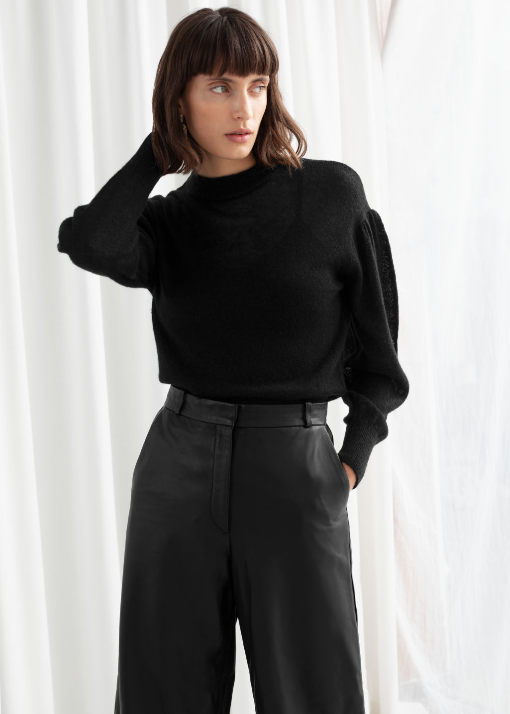 Model front image of Stories wool blend puff sleeve sweater in black