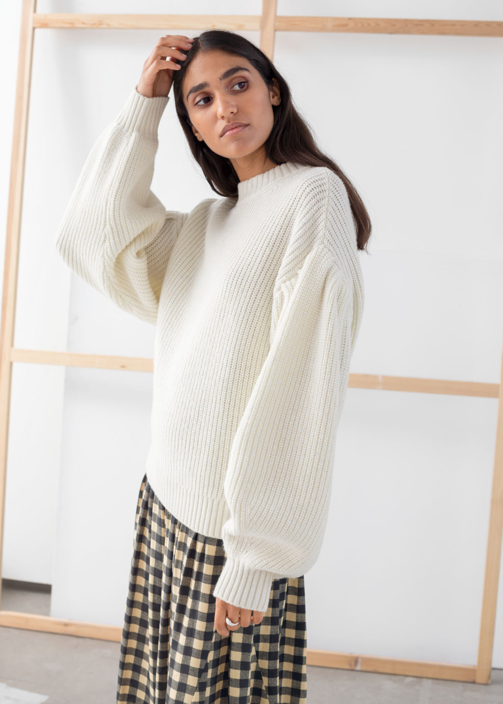 Model front image of Stories chunky ribbed puff sleeve sweater in white