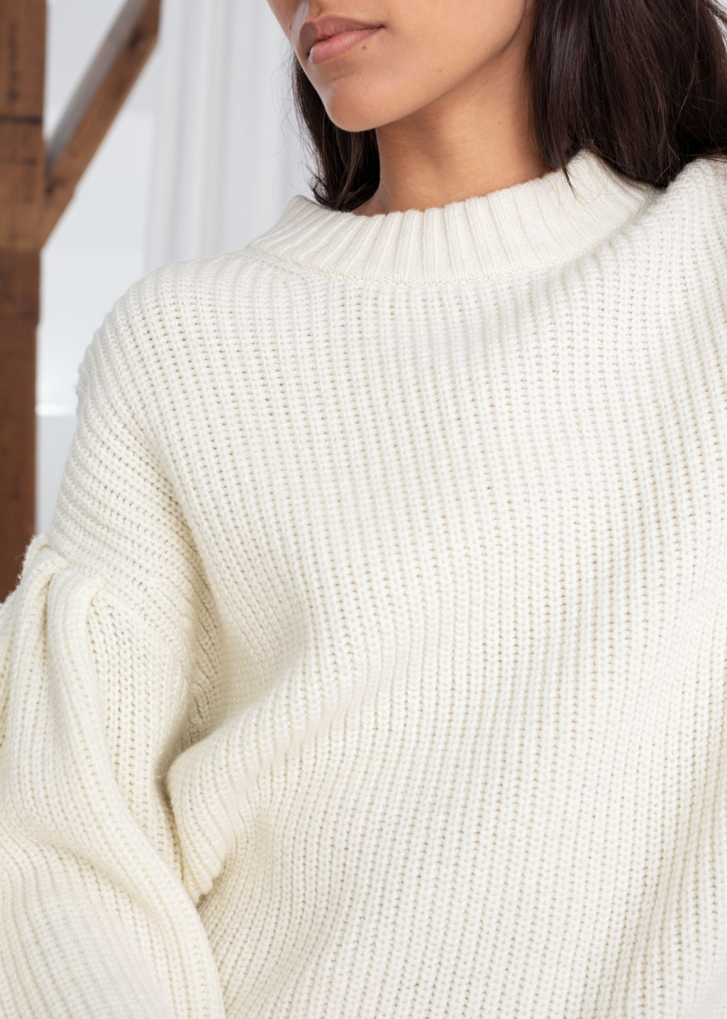 Model back image of Stories chunky ribbed puff sleeve sweater in white