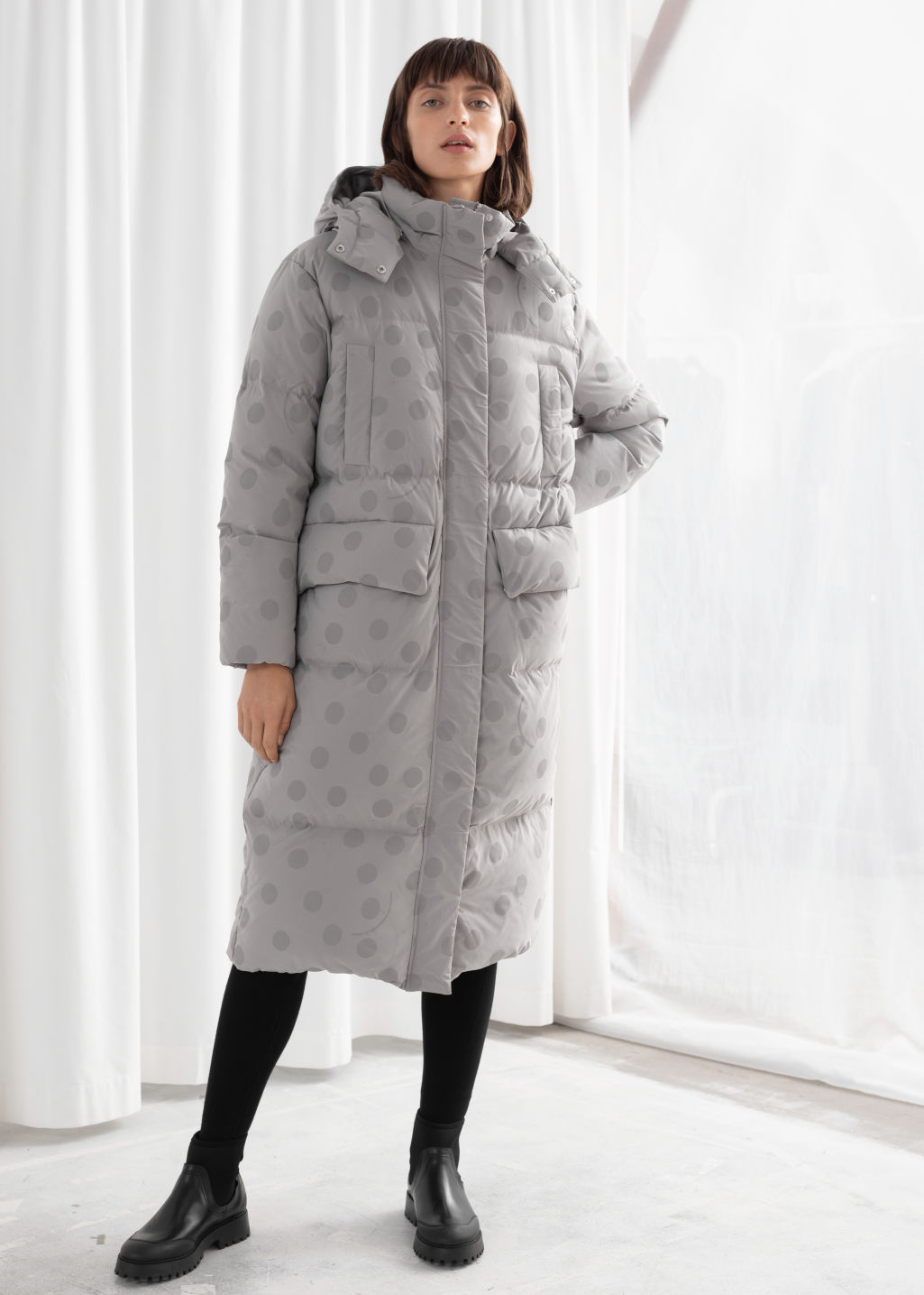 Model front image of Stories oversized polka dot puffer coat in grey