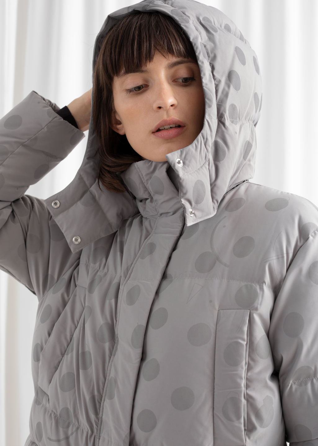 Model side image of Stories oversized polka dot puffer coat in grey
