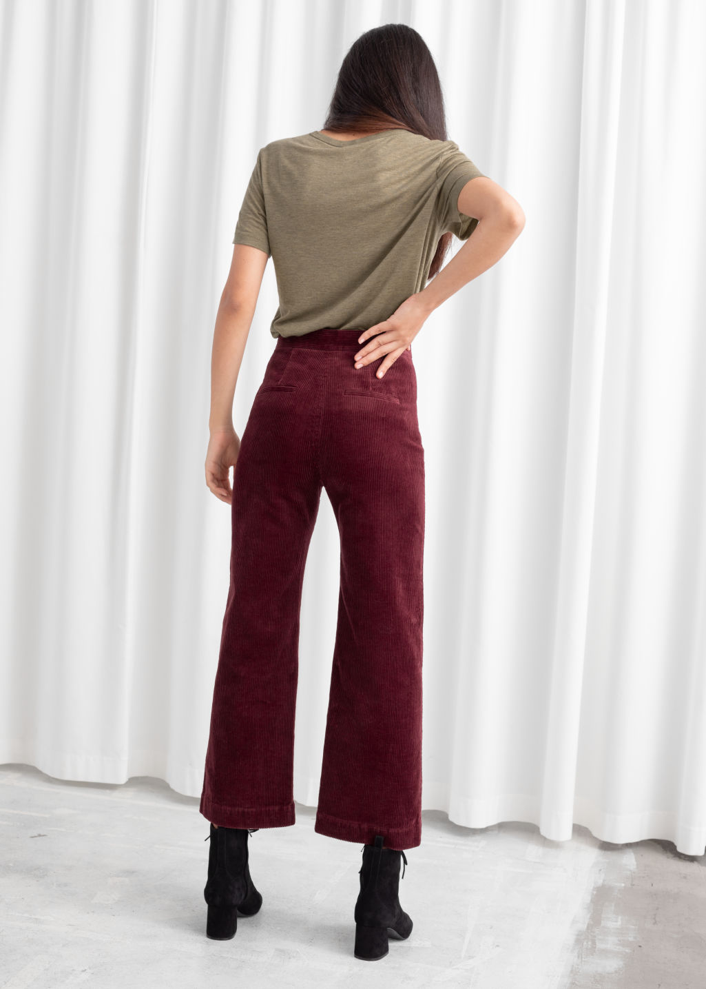 Model back image of Stories relaxed corduroy trousers in red