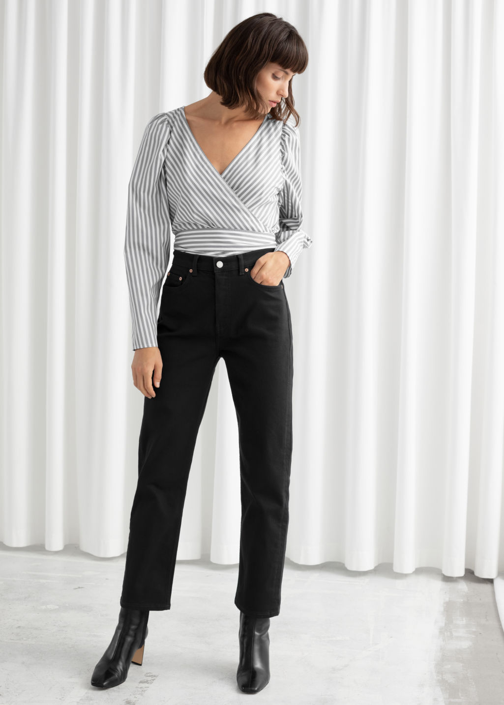 Model front image of Stories straight high rise stretch jeans in black