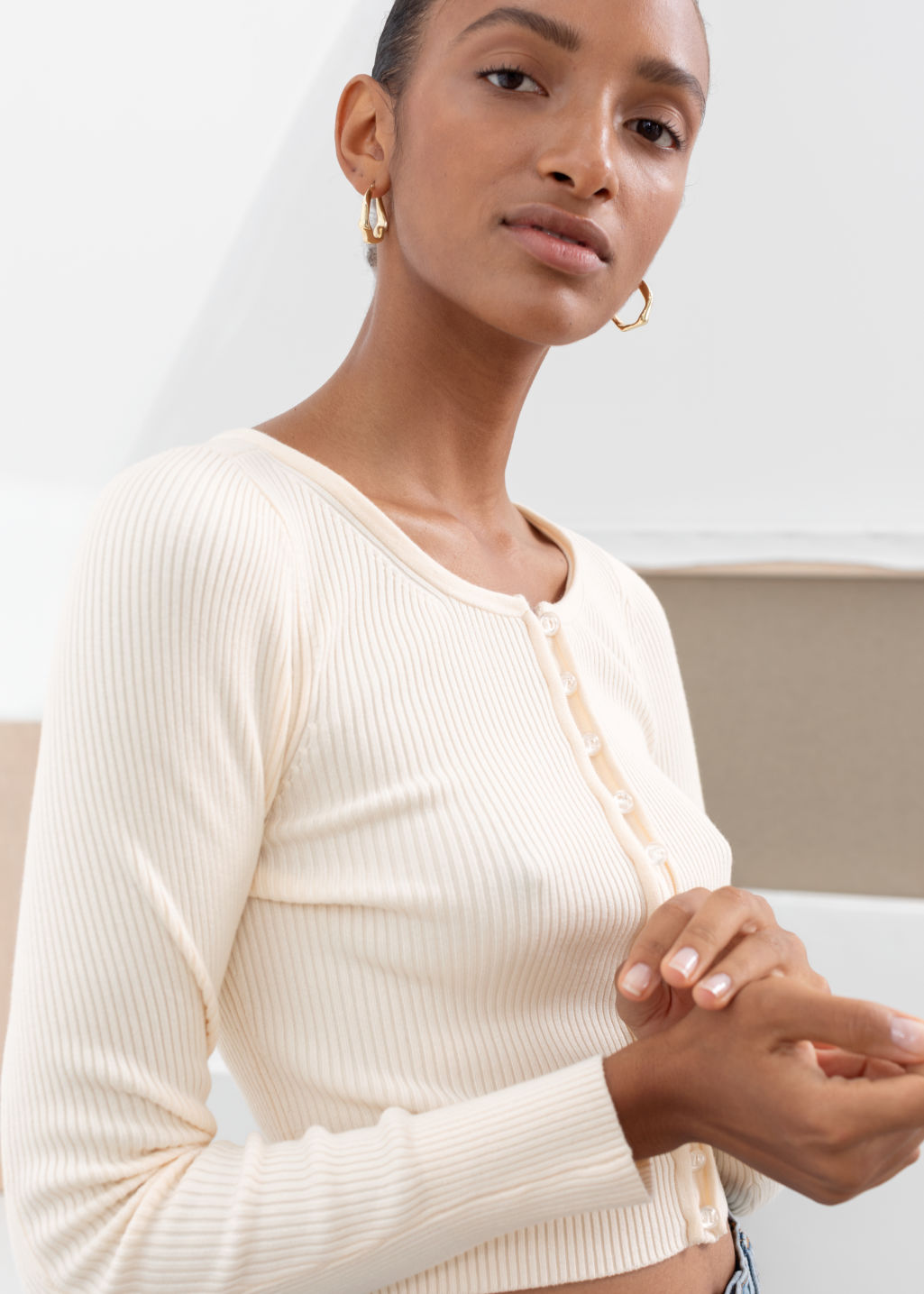 Model front image of Stories ribbed cropped cardigan top in white