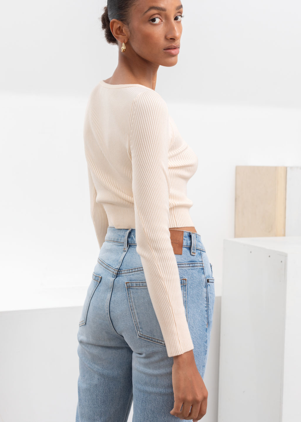 Model back image of Stories ribbed cropped cardigan top in white