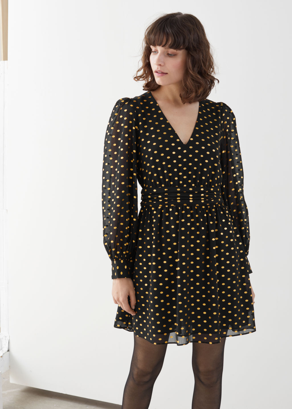 Model front image of Stories metallic dotted gathered mini dress in black