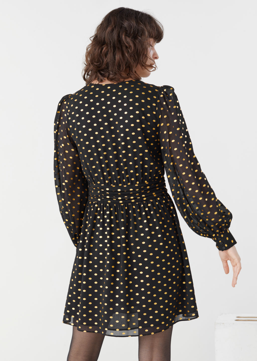 Model back image of Stories metallic dotted gathered mini dress in black