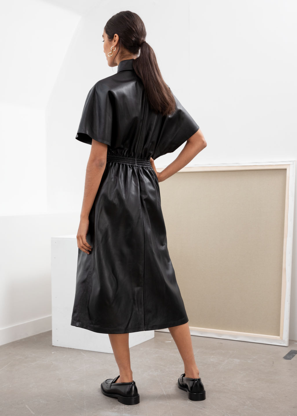Model back image of Stories structured leather midi dress in black