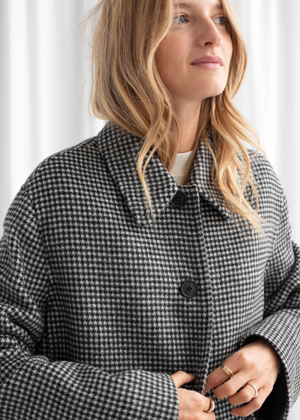 Model back image of Stories houndstooth wool blend long coat in black