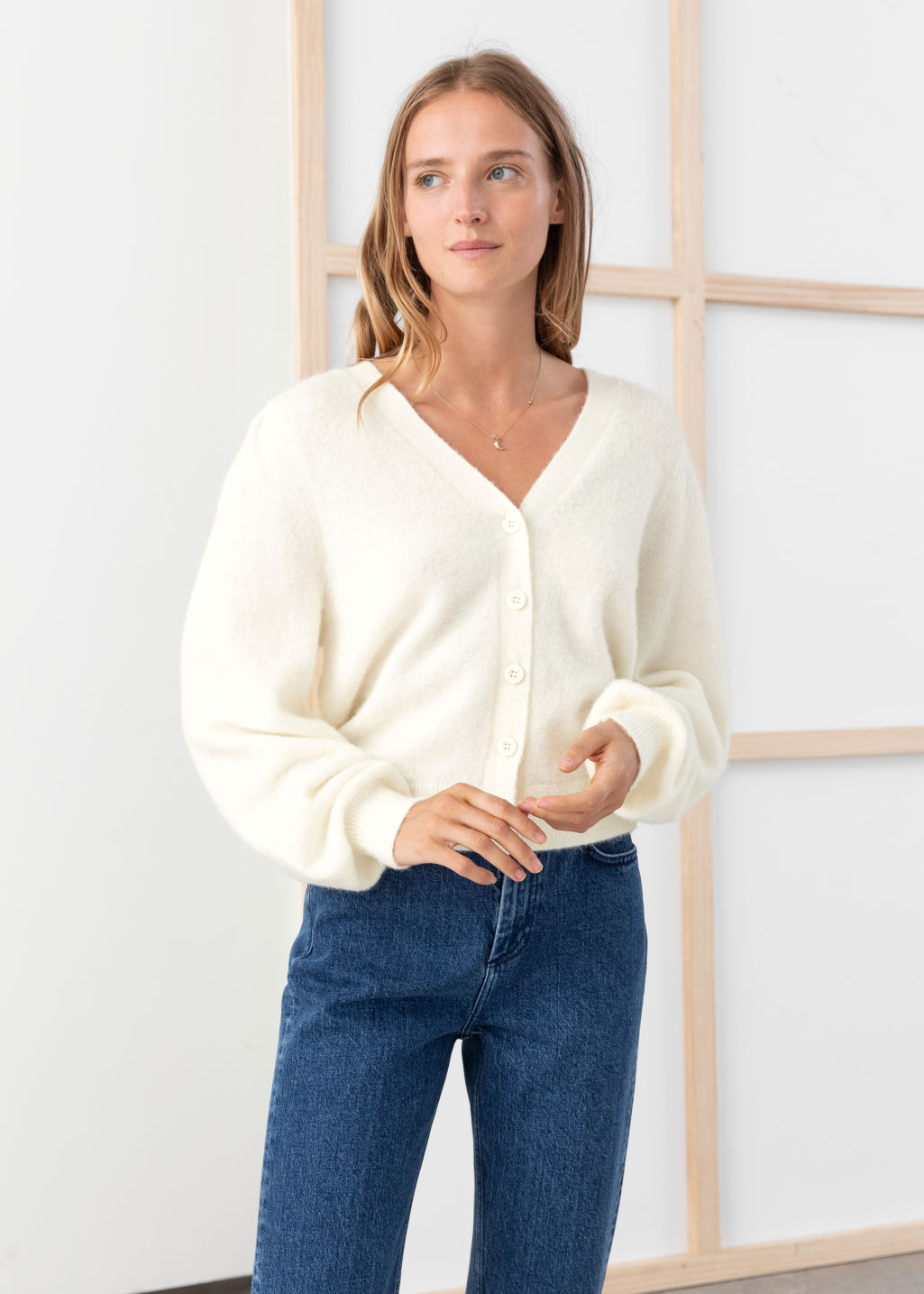 Model front image of Stories wool blend puff shoulder cardigan in white