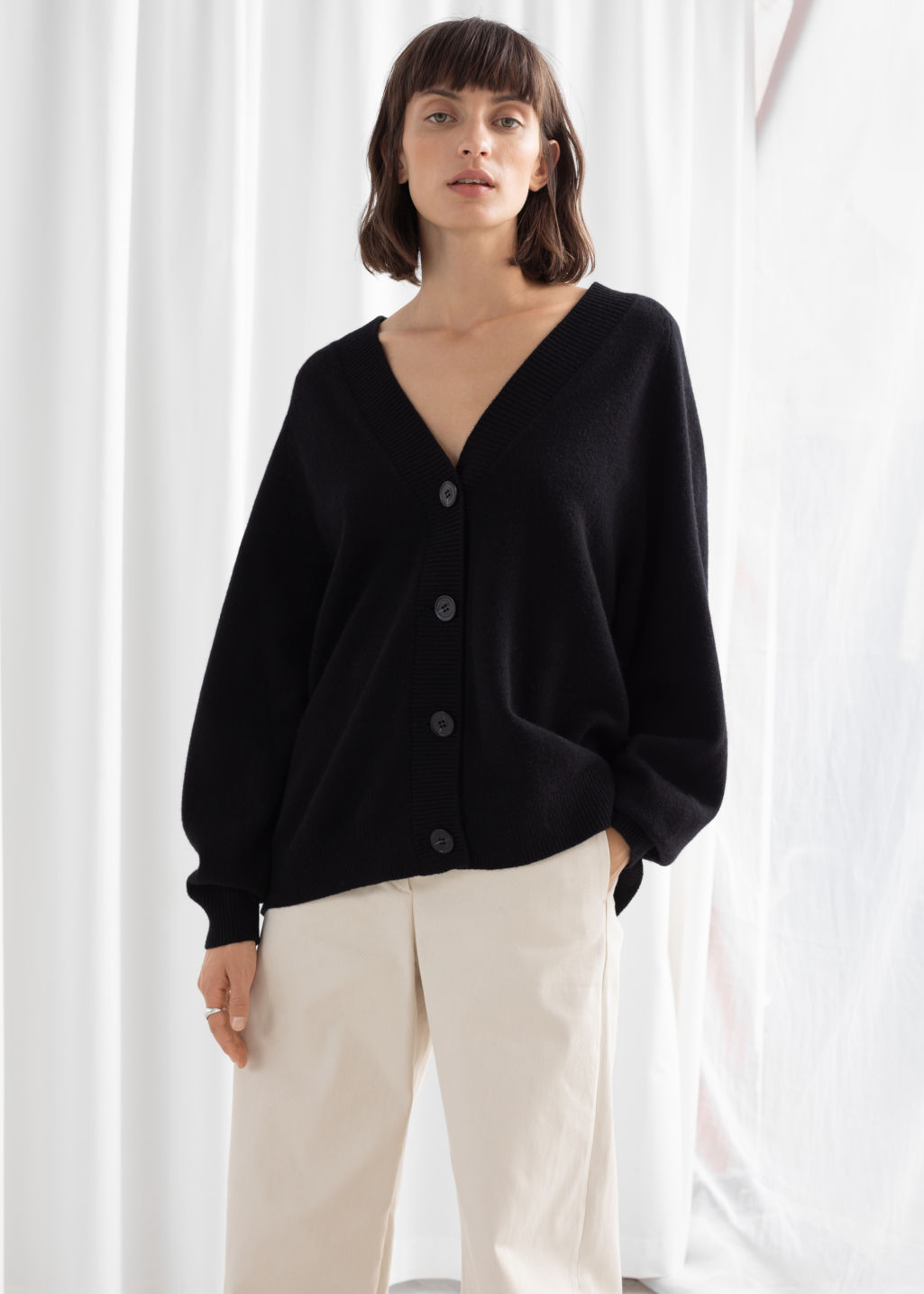 Model front image of Stories oversized wool cardigan in black
