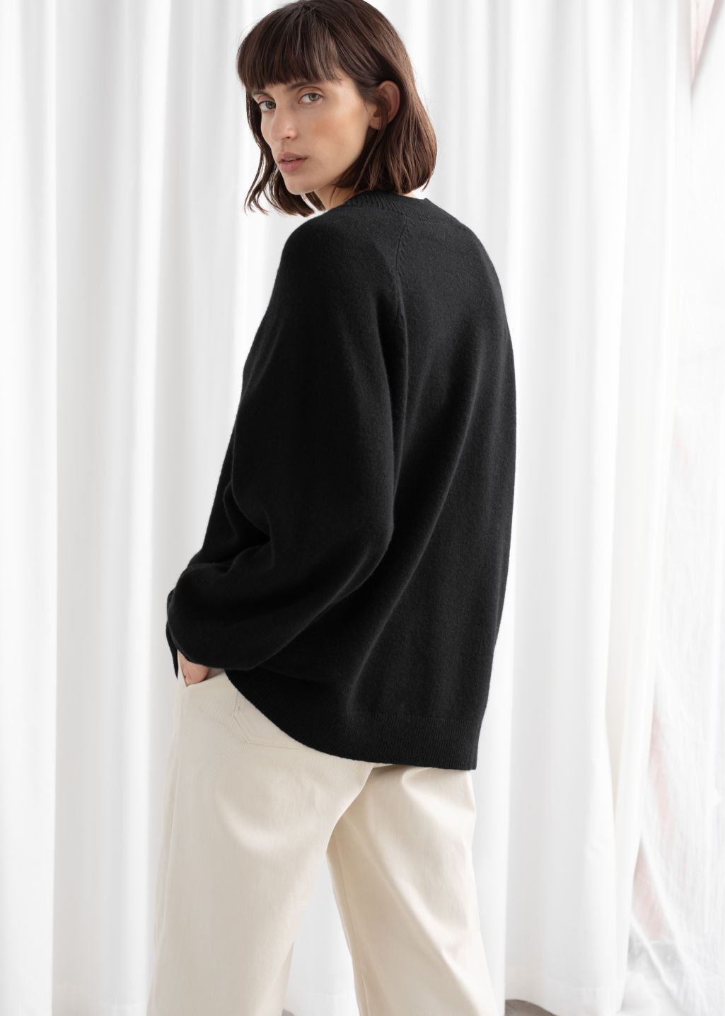 Model back image of Stories oversized wool cardigan in black