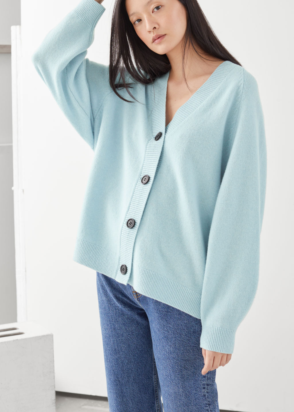 Model front image of Stories oversized wool cardigan in blue
