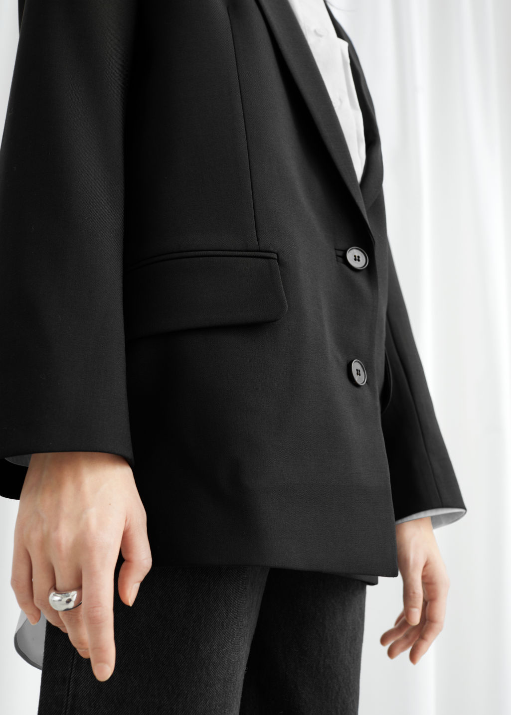 Model front image of Stories oversized wool blend blazer in black
