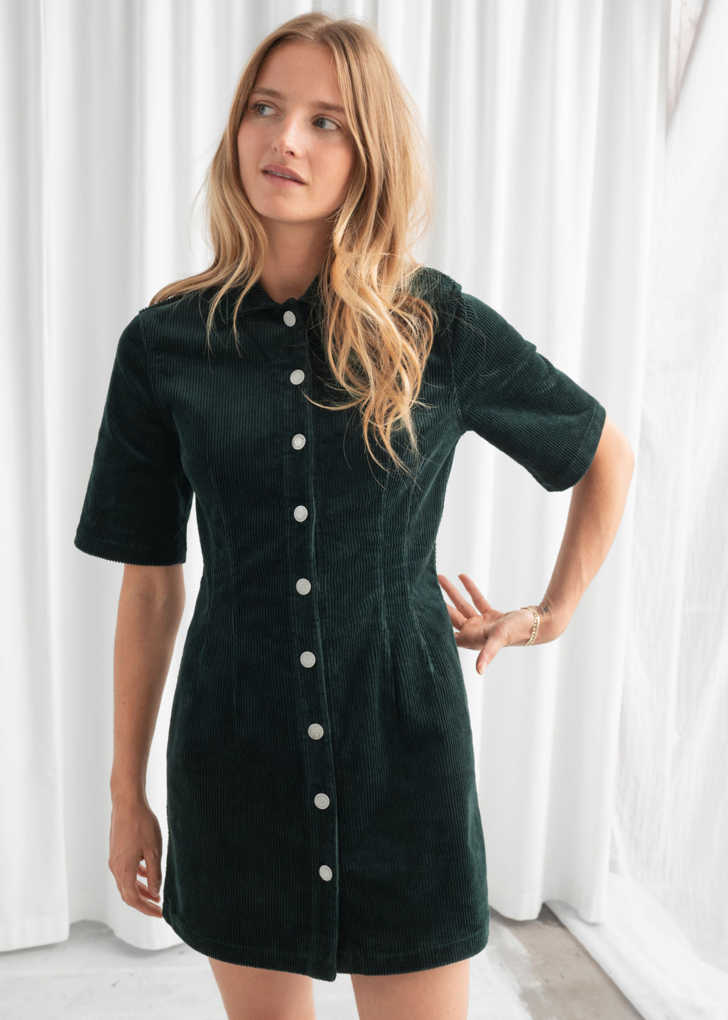 Model front image of Stories corduroy button up mini dress in green