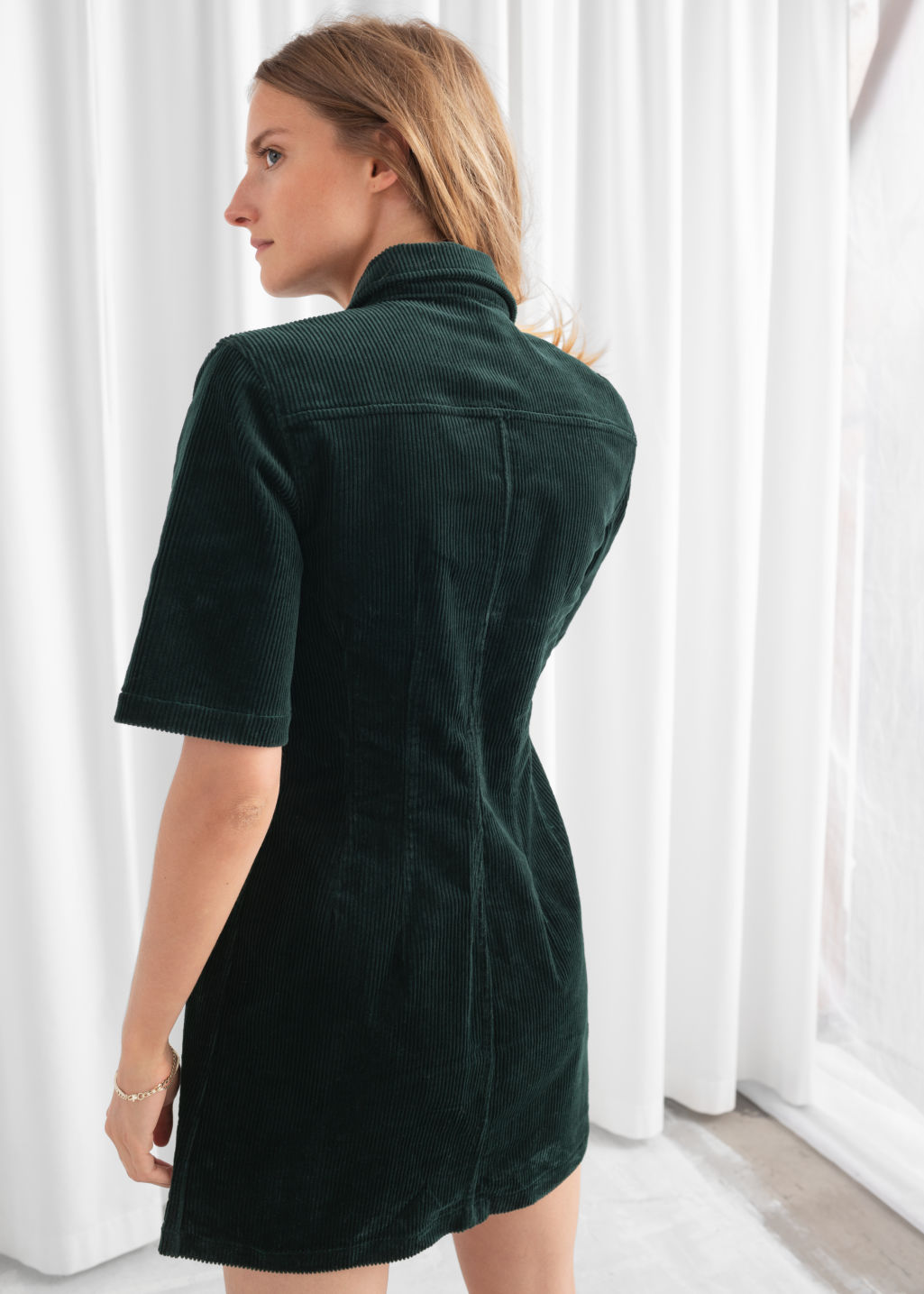 Model back image of Stories corduroy button up mini dress in green