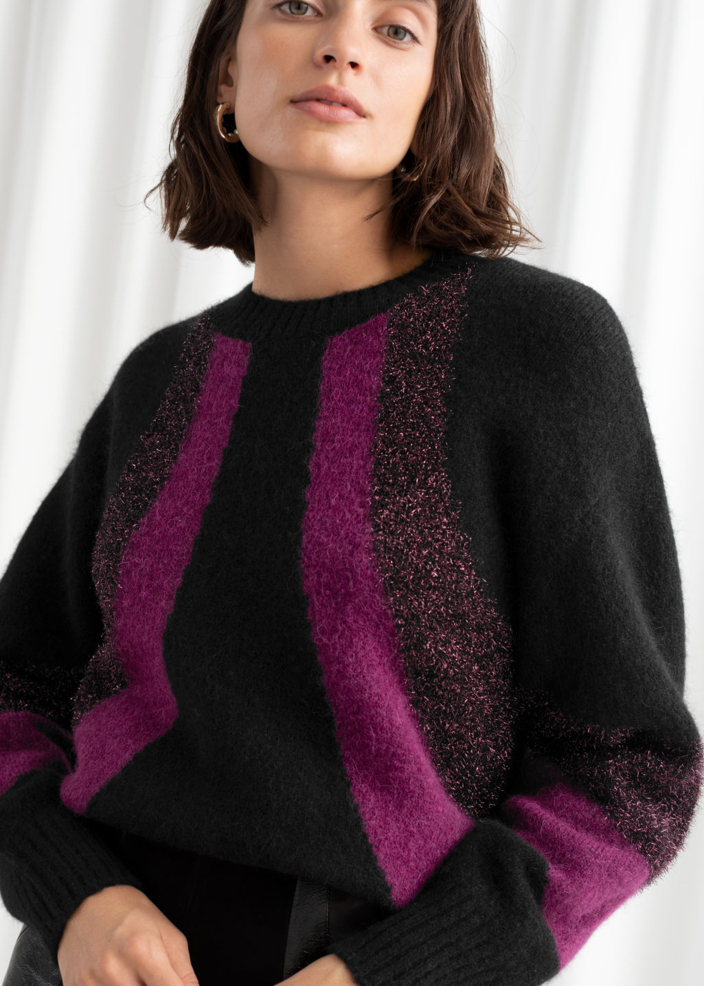 Model front image of Stories glitter colour block wool blend sweater in black